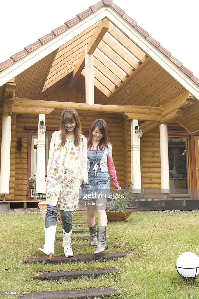 Two young women leaving the cabin : Stock Photo