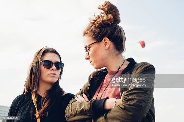 Two young women looking at each other