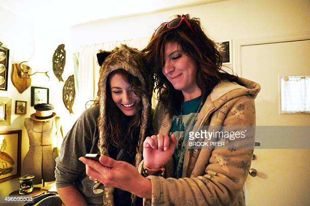 Two young women looking at phone