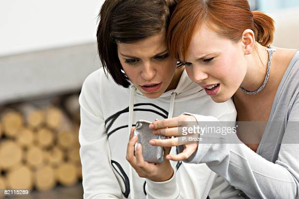Two young women looking into a change purse