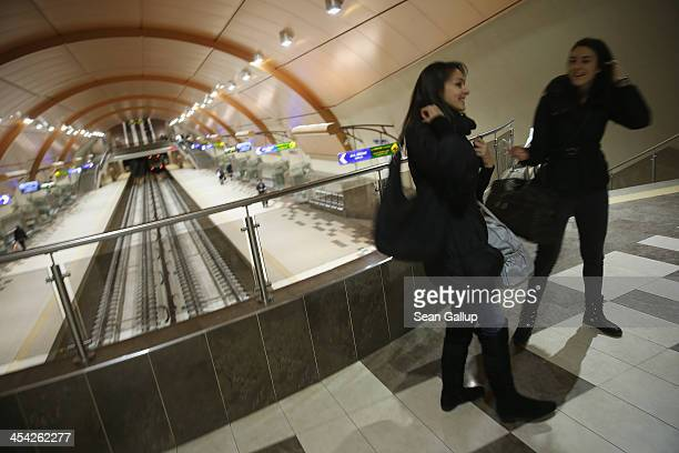Two young women meet up at the Serdica underground station on December 7 2013 in Sofia Bulgaria Restrictions on the freedom of Bulgarians and...