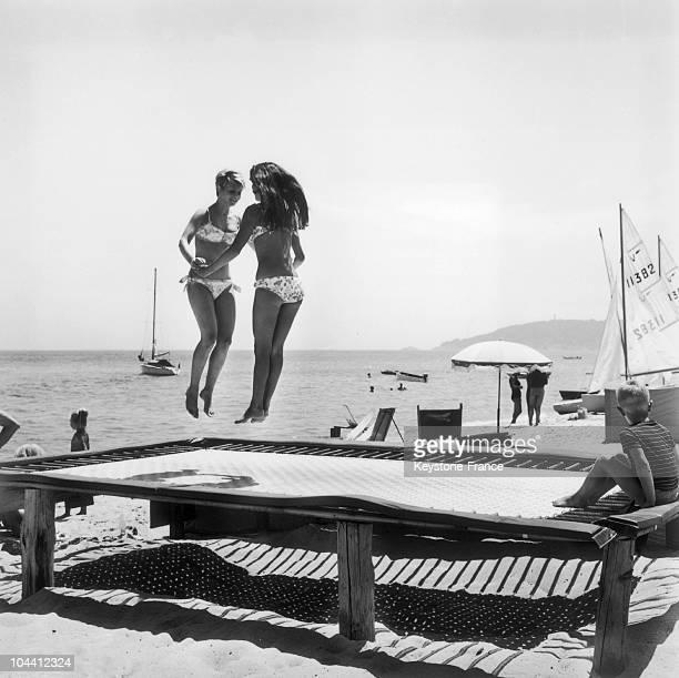 Two young women on a trampoline SaintTropez beach