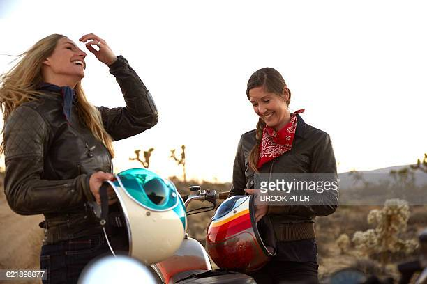 two young women on an adventure with motorcycles - スポーツヘルメット ストックフォトと画像