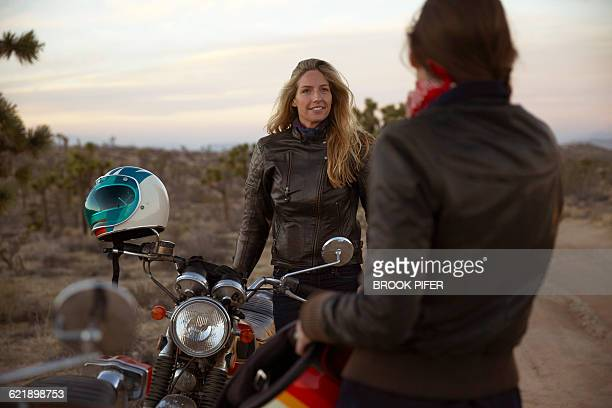 two young women on an adventure with motorcycles - biker jacket stock photos and pictures