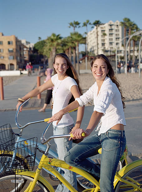 Two young women on bicycles, portrait