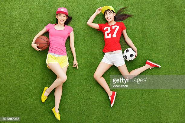 Two young women on grass with balls