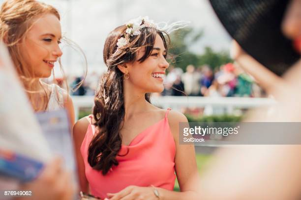 two young women on ladies day - newcastle races stock photos and pictures