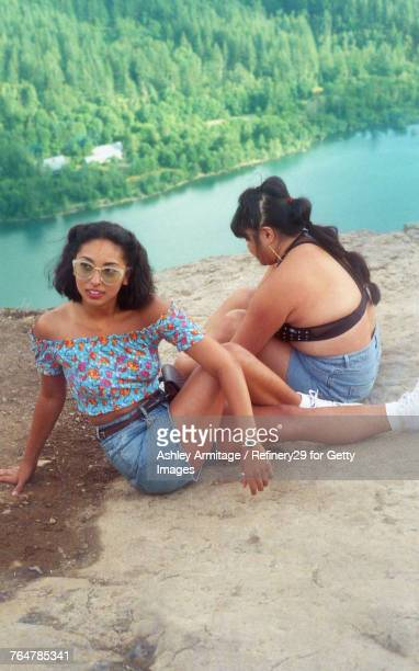 Two Young Women On Mountian Top
