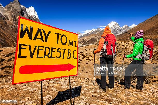 two young women on the way to everest base camp - solu khumbu stock pictures, royalty-free photos & images
