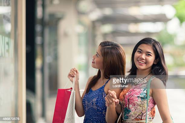 Two young women out shopping