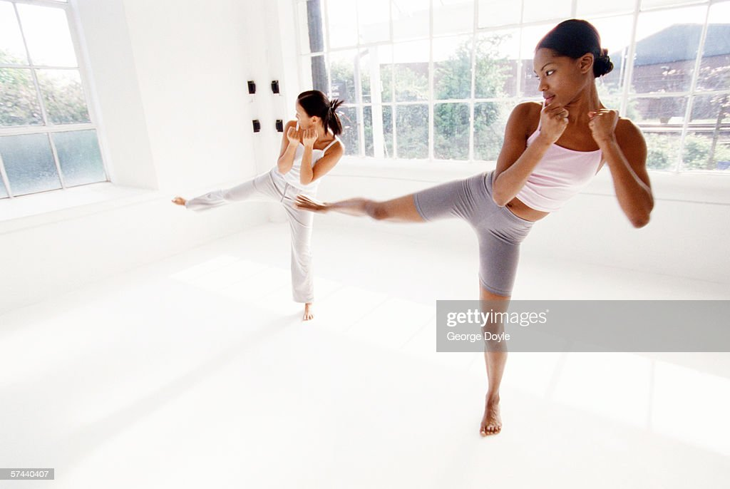 two young women performing martial arts : Stock Photo