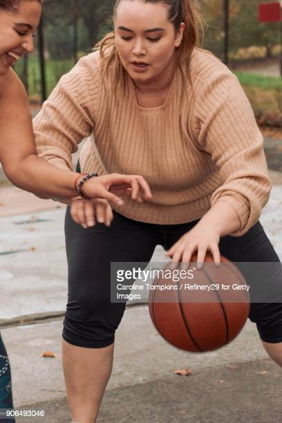 two young women playing basketball - noapologiescollection stock pictures, royalty-free photos & images