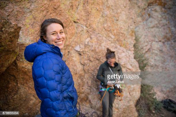 Two Young Women Prepare for a Day of Rock Climbing, Alone in a Canyon