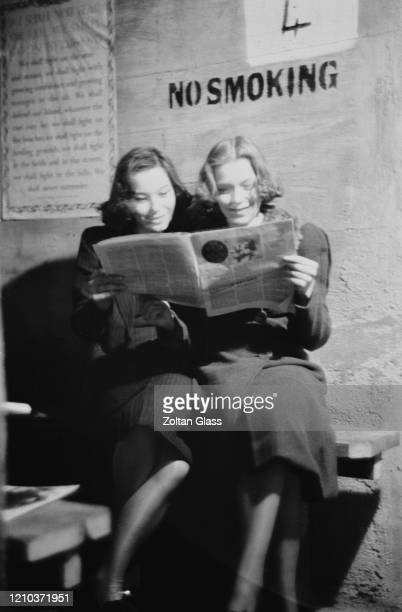 Two young women reading a magazine in an air raid shelter during the Blitz London October 1940 Original Publication Picture Post 308 Shelter Life pub...