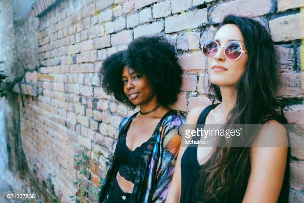 Two young women relaxing on a hot summertime day in the city