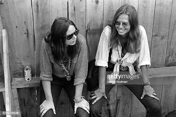 Two young women rest at the Woodstock Music Art Fair Bethel NY August 15 1969