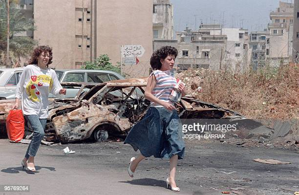 Two young women running away from suden shelling in Christian East Beirut 09 May 1989 At least 356 people have been killed and more than 1600 wounded...
