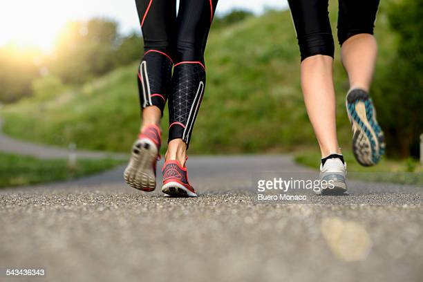 two young women running in the morning, close up