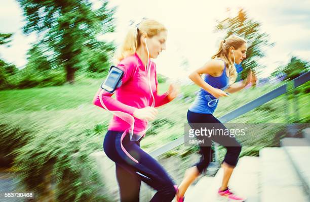 Two Young Women Running Outdoors