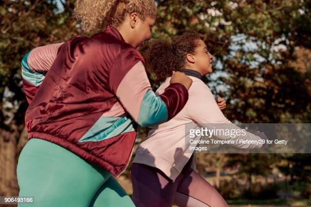 Two Young Women Running