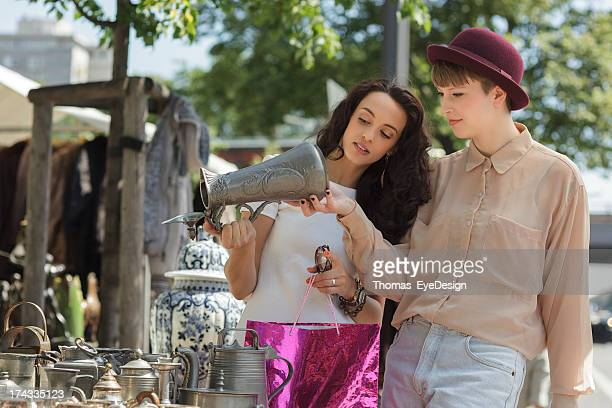 two young women shopping at berlin sunday flea market - flea market stock pictures, royalty-free photos & images