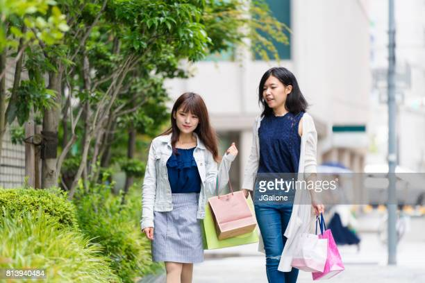 Two young women shopping together in the city