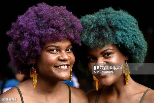 Two young women show AfroColombian hairstyles during the 13th contest of Afro hairdressers Tejiendo Esperanzas in Cali Valle del Cauca department...