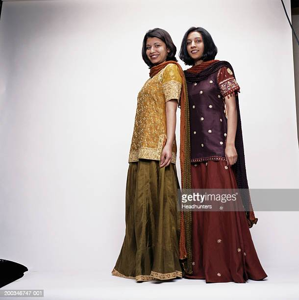 two young women smiling - headhunters stock pictures, royalty-free photos & images