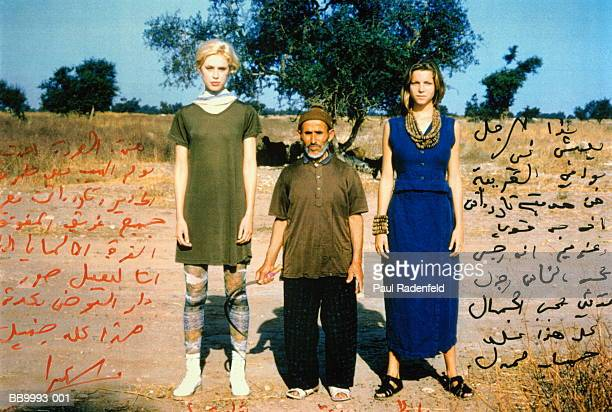 Two young women standing beside local man, Morocco (montage)