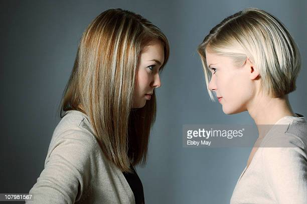 Two young women, standing face to face
