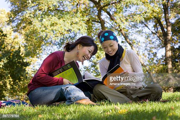 Two Young Women Studying in Park
