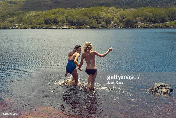 Two young women swimming in a lake
