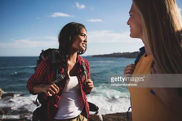Two young women taking a walk outdoors