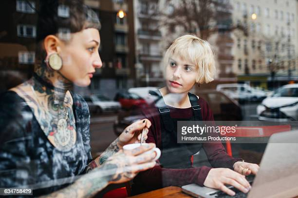 Two young women talking in a café