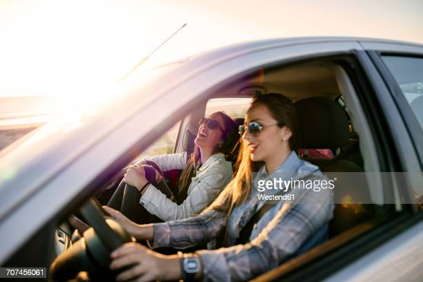 Two young women traveling in a car