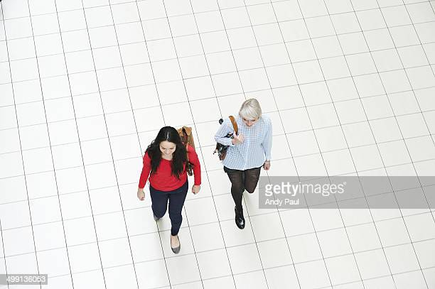 Two young women walking, high angle