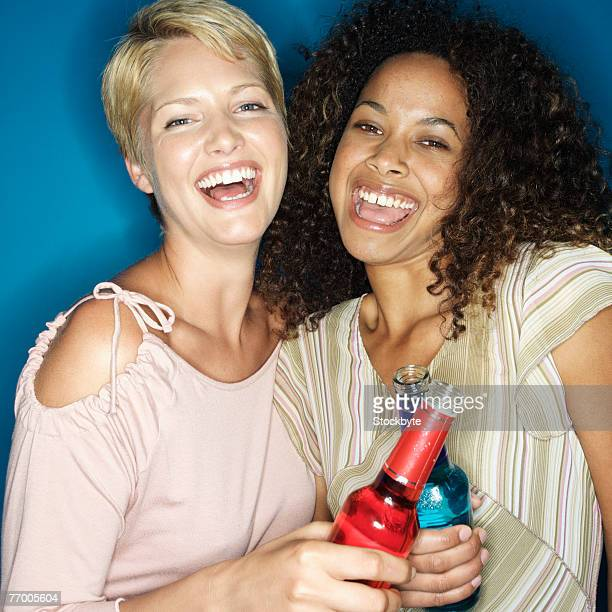 two young women with alcoholic drinks, portrait - open blouse stock photos and pictures