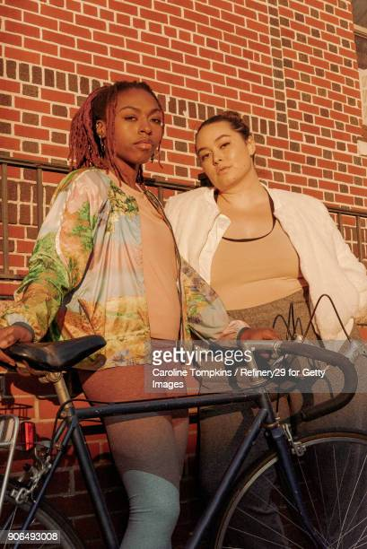 Two Young Women with Bicycle