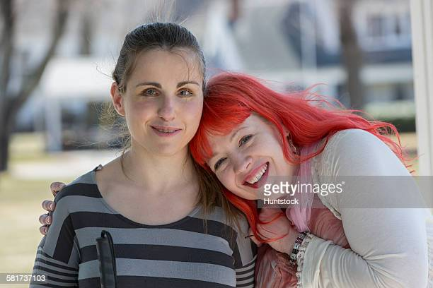 Two young women with visual impairments