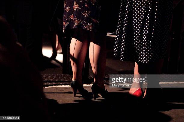 Two young women's seamed stockings a classic look from the 1940s are on show at The Blitz Party on February 22 2014 in London England Deep in an East...