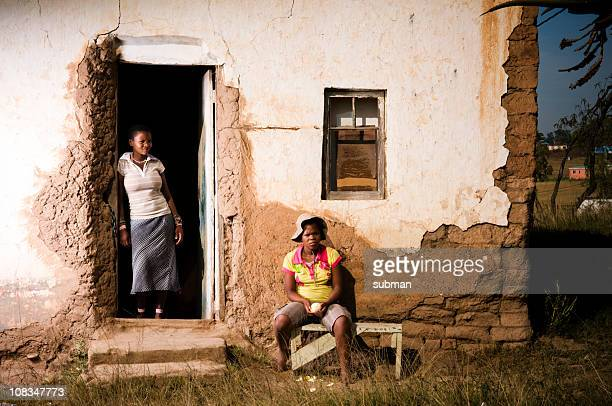 two young xhosa females in front of rural home - eastern cape stock pictures, royalty-free photos & images
