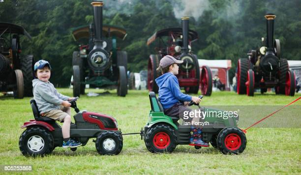 Two youngsters are pulled along in replica tractors during the Duncombe Park Steam Rally on July 1 2017 in Helmsley United Kingdom Held annually in...