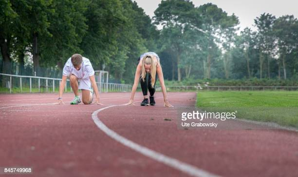 Two youngsters train on a sports ground and start to sprint Staged picture on August 10 2017 in Duelmen Germany