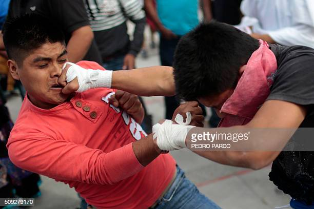 Two youths engage in fisticuffs a facet of the Xochimilcas fight to defend their women against the Aztecs in the Mexican municipality of Zitlala in...