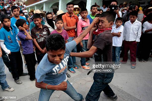 TOPSHOT Two youths take part in the traditional Xochimilcas fight to defend their women against the Aztecs in the Mexican municipality of Zitlala in...