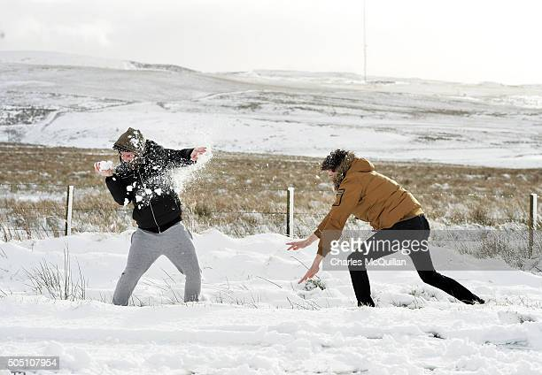 Two youths throw snowballs at one another as they make their way across Black mountain on January 15 2016 in Belfast Northern Ireland The first heavy...