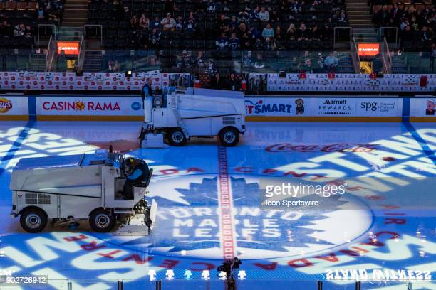 Two Zambonis clear the ice before the regular season NHL game between the Vancouver Canucks and the Toronto Maple Leafs on January 6 2018 at Air...