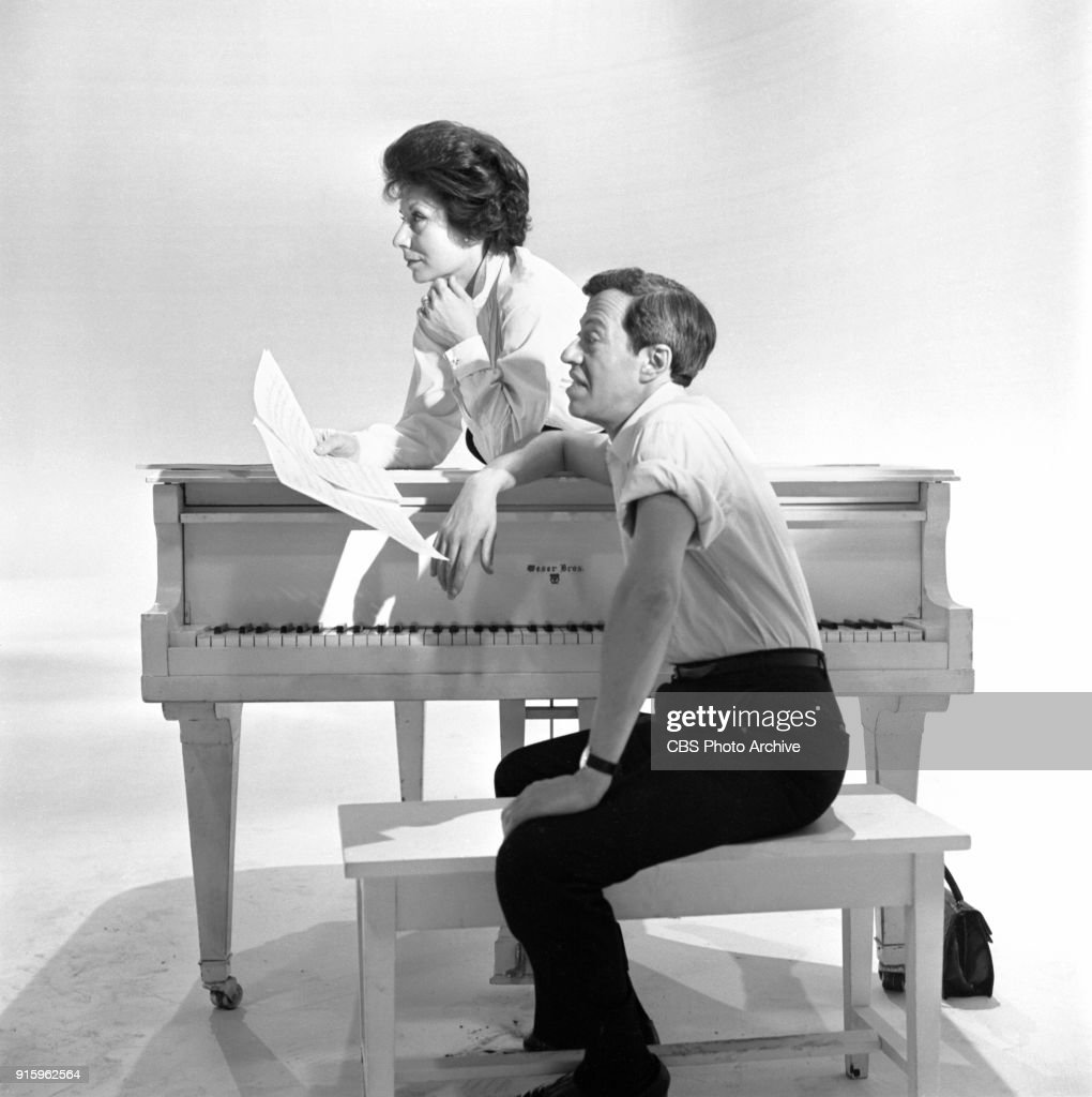 Two-hour CBS television special, The Fabulous Fifties. A review of the previous decade through musical and comedy skits, commentary and news clips. Pictured is Betty Comden (sitting on piano) and Adolph Green at rehearsal. Image dated January 26, 1960. Show date January 31, 1960.