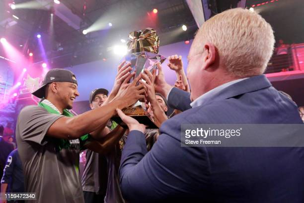 Wolves celebrate with the NBA 2K League Championship Trophy after Game Five of the NBA 2K League Finals on August 3 2019 at the NBA 2K Studio in Long...