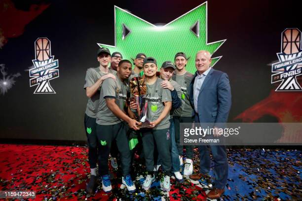 Wolves pose for a group photograph with the NBA 2K League Championship Trophy after Game Five of the NBA 2K League Finals on August 3 2019 at the NBA...